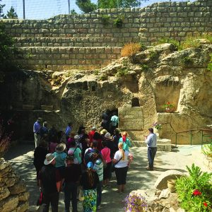 Group of HBU Students and Staff walking into a small cave in Israel.