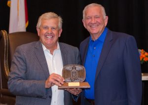 Professional Golfer Colin Montgomerie receiving a Distinguished Alumnus award from HBU President, Dr. Robert B. Sloan.