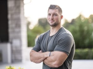 Tim Tebow casual grey shirt