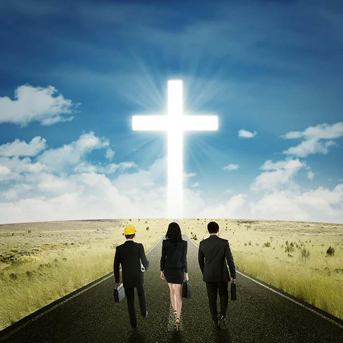 Business team walking toward a cross